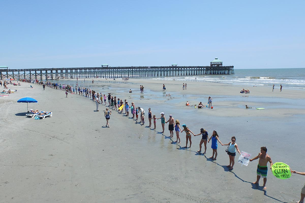 Clean Energy: Hands Across the Sand at Folly Beach in 2015 - Photo by Andy Hollis